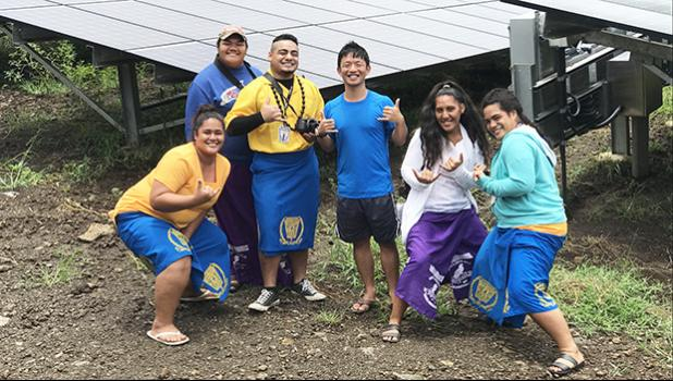 """Senior Policy Specialist for the Pacific Resources for Education and Learning (PREL) in Honolulu, HI Daniel Lin (center) is surrounded by five """"storytellers"""" from Manu'a High School, who submitted stories and photographs as part of the Pacific Storytellers Cooperative last week.  [photo: courtesy]"""