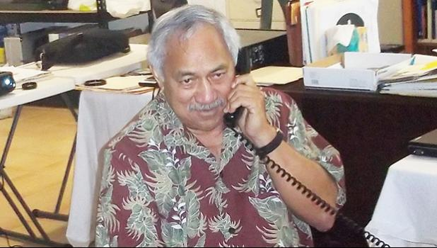 Fleomavaega Eni Hunkin on the phone with a Samoa News reporter on Election Night 2010.  He received 56.3% of the vote in a three-way race. [SN file photo]