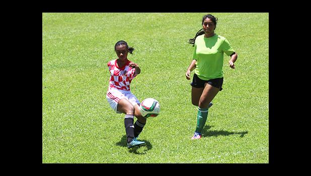 Elsy Lui of Ilaoa & To'omata takes a shot at goal against Lion Heart during a women's game of Match Day 10 of the 2016 FFAS National League at Pago Park Soccer Stadium on Saturday, Oct. 29.  [FFAS MEDIA/Brian Vitolio]
