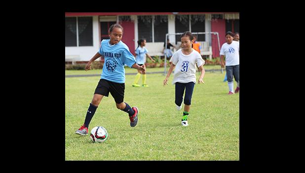 A Kanana Fou 2 player dribbles away from a Pacific Horizons opponent of the 2016 FFAS Private Elementary Schools soccer league's Grades 3-5 Division on Match Day 2 at the Kanana Fou Seminary Field on Thursday, Oct. 20, 2016.  [FFAS MEDIA/Brian Vitolio]