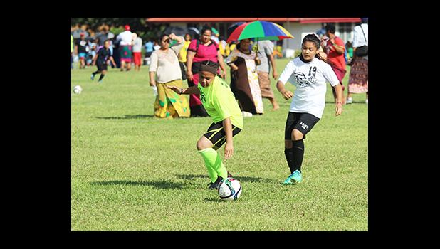 An SPA player, right, and St. Theresa opponent, left, of the Girls 6-8 division in action on Match Day 2 of the 2016 FFAS Private Elementary Schools soccer league at the Kanana Fou Seminary Field on Thursday, Oct. 20, 2016.  [FFAS MEDIA/Brian Vitolio]