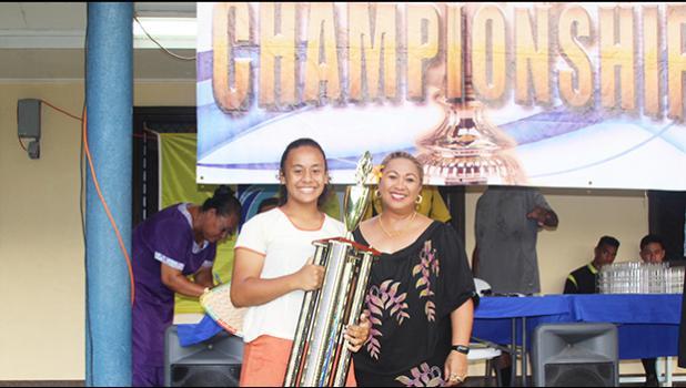 Fa'asao-Marist Cougars' Jordynn Liu-kuey accepts the ASHSAA Girls J-V championship trophy from FFAS Vice-President, and Head of Women's Soccer, Sandra Fruean, at Pago Park Soccer Stadium on Wednesday, March 22, 2017. [FFAS MEDIA/Brian Vitolio]