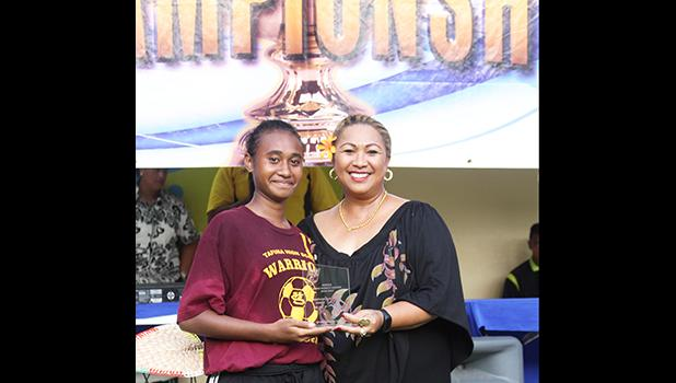 Elcy Lui of Tafuna accepts her ASHSAA Girls Soccer Championship Game MVP award from FFAS Vice-President, and Head of Women's Soccer, Sandra Fruean, at Pago Park Soccer Stadium on Wednesday, March 22, 2017. Tafuna won the championship against South Pacific Academy, ending the private high schools streak of two straight championship titles in the girls' varsity division. [FFAS MEDIA/Brian Vitolio]