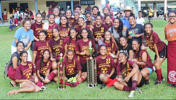 The Tafuna Warriors' team, champions of the ASHSAA Girls varsity soccer season 2016-2017, after beating SPA 2-0 in the final at Pago Park Soccer Stadium on Wednesday, March 22, 2017. [FFAS MEDIA/Brian Vitolio]