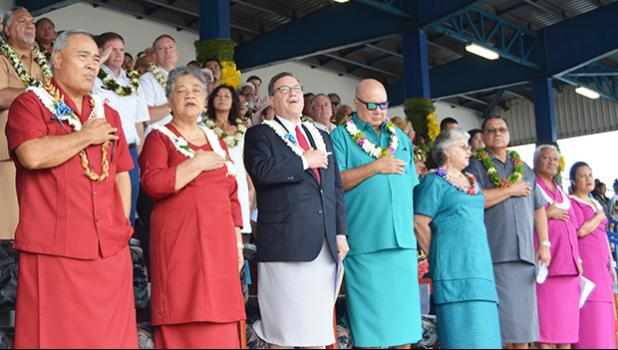 Front ROW during flag raising yesterday for the 2018 Flag Day ceremony at Veterans Memorial Stadium [l-r]  Gov. Lolo Matalasi Moliga n his wife Cynthia Moliga; U.S. Interior Assistant Secretary for Insular and International Affairs, Doug Domenech; Chief Justice Michael Kruse and his wife Gail; Senate President Gaoteote Tofau Palaie; and House Speaker Savali Talavou Ale and his wife. [photo: AF]
