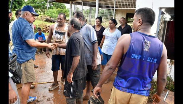 Fiji Prime Minister Frank Bainimarama visits a community in Ba which was hit by floods caused by Cyclone Josie. [Photo: Fijian Government via RNZI]