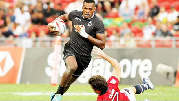 Fiji powers on 40-0 vs Hong Kong in the Singapore Sevens, Day 1, National Stadium, Singapore.   [Photo: Barry Markowitz]