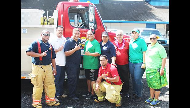 Fire Chief O'Brien and his crew, along with officials from the School Lunch Program, following a presentation by the Fire Dept. last Thursday during the week-long food safety training workshop for all SLP cooks and food handlers. See story for full details.   [Courtesy photo]