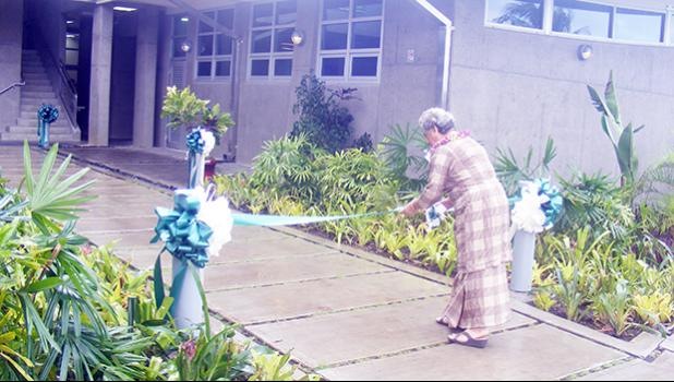 First Lady Cynthia Malala Moliga cutting the ribbon during the official dedication ceremony of the American Samoa Power Authority's new $4.6 million Operations Center building at its Tafuna compound last Friday morning.  [photo: FS]