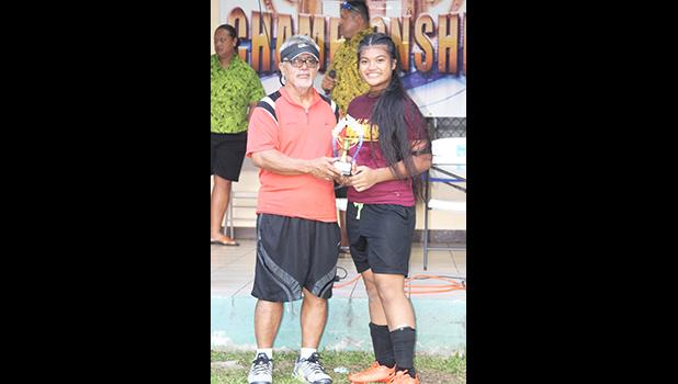 Frieda Vaaimamao, right, of the Tafuna Warriors receives her ASHSAA Girls J-V MVP award DOE's Liatama Amisone Sr. on Wednesday, March 14, 2018 at Pago Park Soccer Stadium.  [FFAS MEDIA/Brian Vitolio]