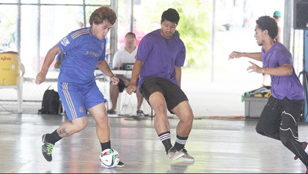 A Green Bay A player dribbles the ball as two PanSa opponents converge on him during Match Day 3 of the 2017 FFAS Futsal Tournament at Samoana High School's gym in Utulei on Saturday, May 20, 2017.  [FFAS MEDIA/Brian Vitolio]