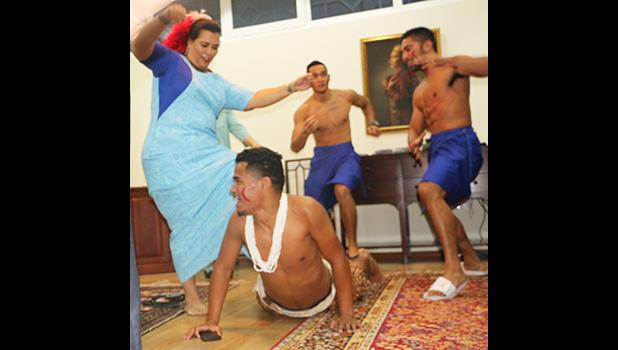 """Team A.S. Press Attache Terry Custodio Auva'a and the athletes to perform the Taualuga, and the Ambassador's wife Ann was dancing with them also, """"We had all the guests dancing in the end, it really was a fun night!"""" said Auva'a.  (Photo:Team American Samoa)"""