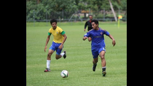 Green Bay's Pamata Punefu, right, dribbles against Vaiala Tongan's Mahonri Lotulelei in a men's game on Match Day 5 of the 2016 FFAS National League on Saturday, Sept. 17, 2016 at Pago Park Soccer Stadium.
