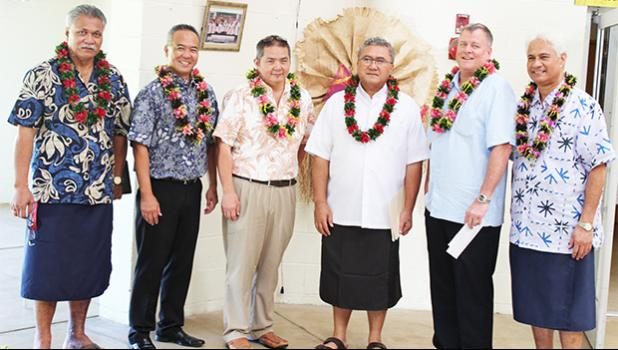 [l-r] Hope House board chairman Ta'afano Joe Tavale; BoH executive EJ Tyler Ozu; BoH executive Jon Murakami;  Monsignor Viane Etuale, Vicar General of the Diocese of Samoa Pago Pago; BoH executive Hobbs Lowson; and Hope House board member Larry Sanitoa, chairman of the Hope House 30th Anniversary Committee - pictured yesterday before BOH executives made its annual $10,000 donation to Hope House.  [photo: FS]
