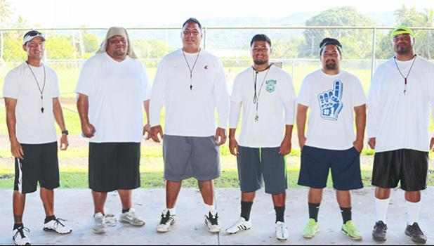 Lions coaching staff led by Head Coach Okland Salave'a (center) posing for a group photo just before practice in August 2016. [SN file photo]