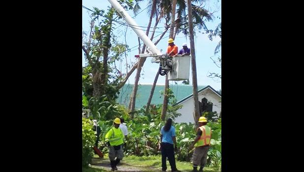 American Samoa Power Authority crews seen yesterday working on restoring electricity to family homes in Ili'ili that have been without power since last week Friday — after Tropical Storm Gita swept through Tutuila. [photo: courtesy]