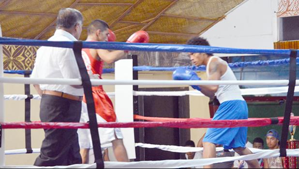 Faasala Livai (right) of Samoa looks on while Kaisa Ioane (left) of American Samoa was trying to attack during their match of the International Boxing Championship between the two Samoa last weekend at the Maliu Mai Beach Resort. [photo AF]