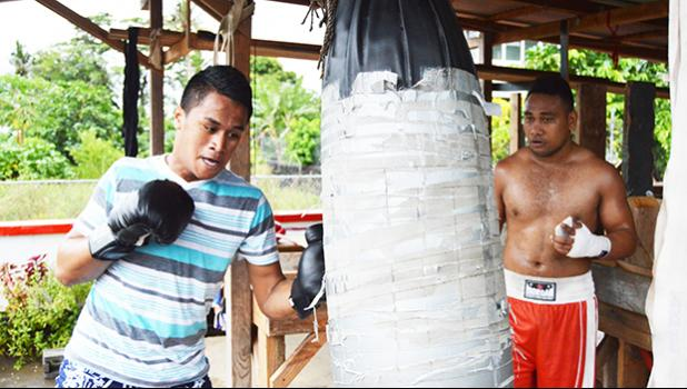 "One of American Samoa's rising stars Jeffrey Tago (left) during his training for the ""2Samoa Battle"" this weekend, with Petelo Matagi of Samoa (right) who is helping him out. [photo: AF]"