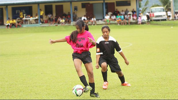 A Tafuna Jets player receives a pass as a Black Roses opponent defends during a game of the women's 2017 FFAS National League on Saturday, Sept. 23 at Pago Park Soccer Stadium.   [FFAS MEDIA/Brian Vitolio]