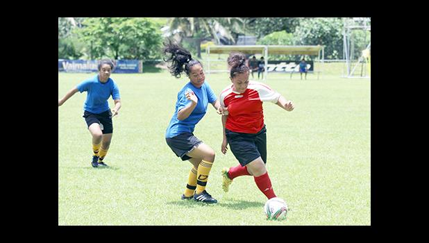 Vasati Makiasi, right, of the Tafuna Jets dribbles past a Royal Puma defender, during the women's FFAS National Cup game on Match Day 9 of the 2016 FFAS National League at Pago Park Soccer Stadium on Saturday, Oct. 22, 2016.  [FFAS MEDIA/ Brian Vitolio]