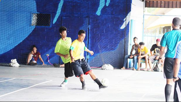 Bryman Levaula of Tafuna Jets 2 tries to control the ball against Lion Heart A's Jordan Leilua on Match Day 3 of the 2017 FFAS Futsal Tournament at Samoana High School's gym in Utulei on Saturday, May 20, 2017.  [FFAS MEDIA/Brian Vitolio]