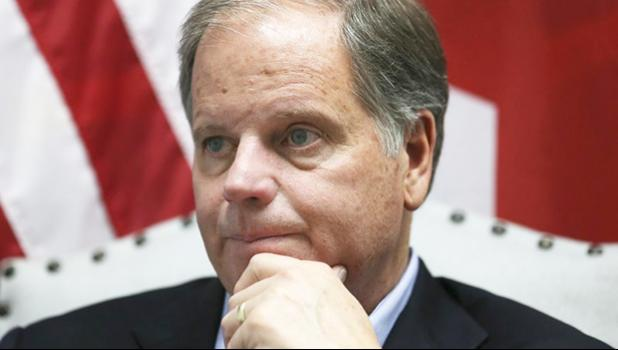 "In this Dec, 13, 2017 file photo, Democrat Doug Jones speaks during an interview with the Associated Press, in Birmingham, Ala. Alabama Secretary of State John Merrill dismissed the viral story that over 5,000 of the votes for Jones in Tuesday's special U.S. Senate election were cast by the dead. ""There are not 5,000 dead people on the voters rolls unless they died today,"" Merrill told the AP Thursday, Dec. 14. (AP Photo/John Bazemore)"