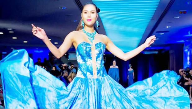 """One of Cecilia Keil's garments featuring in the parade: """"Drowning Paradise""""The bare centre piece in the middle representing Land and everything else is ocean. [Samoa Observer]"""