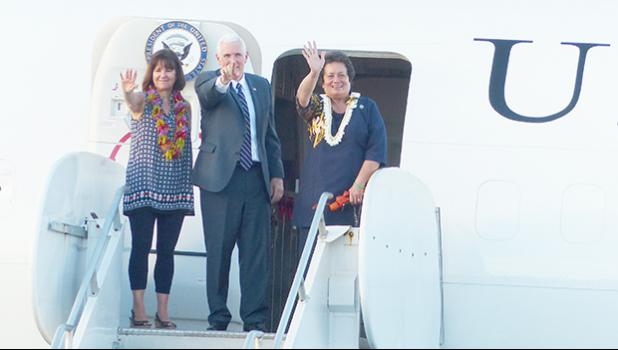 Congresswoman Amata, Vice President Pence and Second Lady Karen Pence wave to the crowd gathered at Pago Pago Intl Airport before departing for Honolulu on Air Force II.  [Courtesy photo]