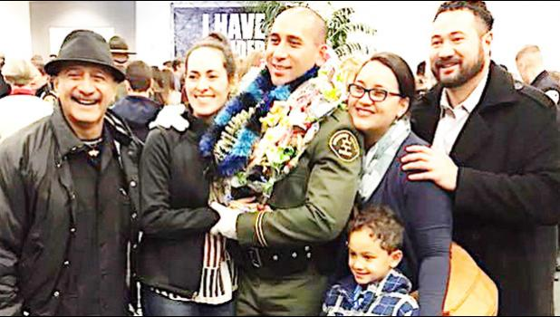 "Newly sworn-in Monterey County Deputy Sheriff, Tautaimatapala Anthony Langkilde with family members and a friend, following his graduation ceremony last month. A native of American Samoa, Langkilde is the son of Tamatoa Tony (far left) and the late Bernadette ""Pele"" Scanlan. He was among the Dec. 17, 2017 graduates of the South Bay Regional Academy.  [photo: Langkilde family]"