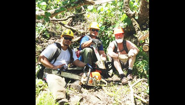 Leon Ezbitski of Pittston, Pennsylvania with the NPAS crew clearing trails in the National Park of American Samoa, after Park trails were blocked by hundreds of downed trees from Tropical Storm Gita. He took time off his vacation in American Samoa to volunteer.   [courtesy photo]