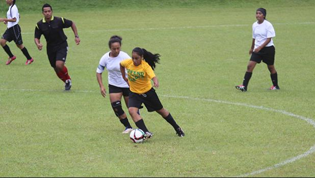 Oloataua Tofaeono of the Leone Lions dribbles the ball while being defended by the Fa'asao-Marist Cougars' Jordynn Liu-Kuey during an ASHSAA varsity girls' soccer game on Saturday, Feb. 24, 2018 at Pago Park Soccer Stadium.  [FFAS MEDIA/Brian Vitolio]