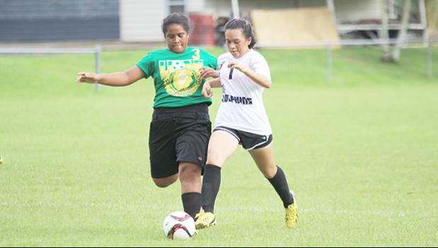 Michelle Wisneske (#7) of South Pacific Academy, and Leone Lions' Frances Nautu (#3) battle for possession of the ball during an ASHSAA Girls varsity soccer game on Monday, Feb. 6, 2017 at Pago Park Soccer Stadium.  [FFAS MEDIA/Brian Vitolio]