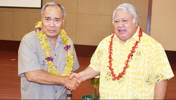 This photo by Apia-based journalist Joyetter Feagaimaali'i, provided to Samoa News for publication with permission, shows American Samoa Gov. Lolo Matalasi Moliga (left) shaking hands with Samoa Prime Minister Tuilaepa Sailele Malielegaoi, before the start of the Nov. 30th executive session of the Two Samoa Talks at the Tui Atua Tupua Tamasese Efi Convention Center in the heart of Apia.  [photo: Joyetter Feagaimaali'i]