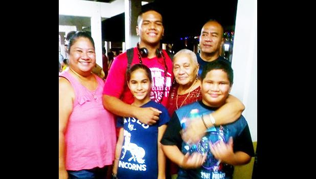 Samoana HS football standout Fautua Tufue Maiava Jr. with two of his siblings, parents Flo and Fau, and Grandma Faimalie Tua at the airport, prior to his departure earlier this month to play in the 2017 JPS Classic in Hawaii.  [photo: BC]