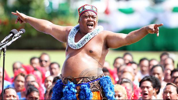 The StarKist Samoa group of 1,000 performers on the malae at Veterans Memorial Stadium during the siva and pese for 2014 Flag Day on Apr. 17.  [SN file photo / Barry Markowitz]