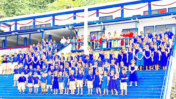 Teachers and students from Marist Saint Francis School in Lepua, posed for a photo during an assembly last week. [courtesy photo]