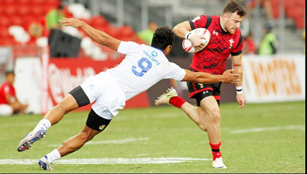 Defender Tila Mealoi and his Manu Samoa teamates played strong to the end in their Trophy Semi Final but bowed out to Wales 14-19.Singapore HSBC Sevens, Day 2, National Stadium, Singapore. [Photo: Barry Markowitz]