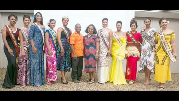 Miss Pacific Islands Pageant 2017 Contestants and reigning Miss Pacific Islands, Anne Dunn with Rev. Dr. Bird and his wife of Council World  Mission who officially opened the Interview presentations with a prayer. [courtesy photo]