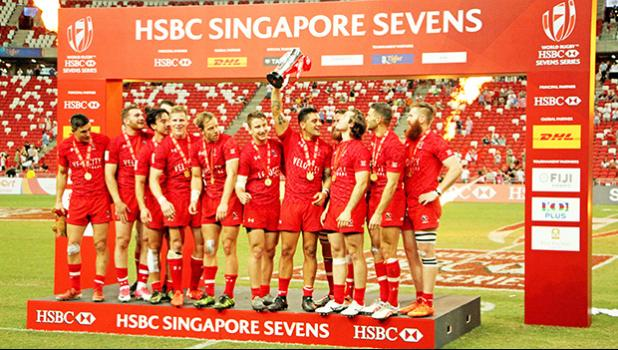Canada 7s player, Mike Fuailefau proudly raises the HSBC Singapore 7s Cup after his team defeated the USA Eagles 6-19 at the Singapore HSBC Sevens, Day 2, National Stadium, Singapore.  [Photo: Barry Markowitz]
