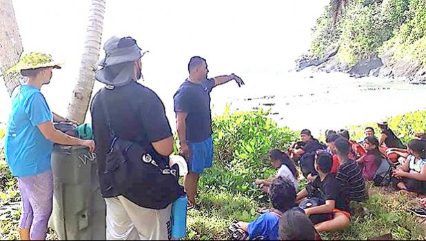 Peter Taliva'a and the crew from the National Marine Sanctuary of American Samoa partnered up with South Pacific Watersports earlier this month to escort the more than three dozen kids enrolled in the 2017 FIT program to Fogama'a and Aunu'u. [Courtesy photo]