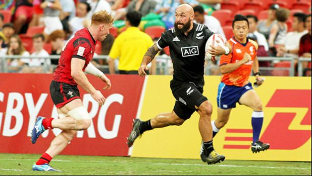 Captain DJ Forbes advances the ball in the All Blacks' 36-14 victory over Wales at the Singapore Sevens, Day 1, National Stadium, Singapore. [Photo: Barry Markowitz]