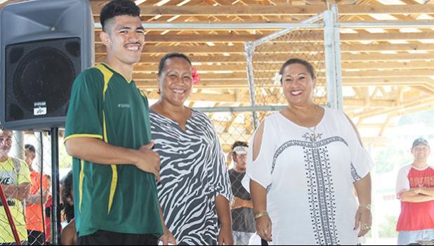 Ne'emia Kaleopa, left, of Utulei Youth receives his 2017 FFAS Futsal Tournament MVP award from FFAS executive member Amio Mavaega-Luvu (middle) and FFAS Vice- President and FIFA Council member Sandra Fruean (right), on Monday, May 29 at the Samoana High School gymnasium in Utulei.  [FFAS MEDIA/Brian Vitolio]