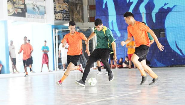 Ne'emia Kaleopa of Utulei Youth (middle) controls the ball against Royal Puma's Willie Malele (right) and TJ Tauamo (left) during their 2017 Futsal Tournament's pool game at Samoana High School's gymnasium on Saturday, May 6, 2017.  [FFAS MEDIA/Brian Vitolio]