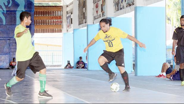 Rambo Tapui (right) of Pago Youth 1 in action against a Lion Heart A opponent during their 2017 Futsal Tournament's pool game at Samoana High School's gymnasium on Saturday, May 6, 2017.  [FFAS MEDIA/Brian Vitolio]