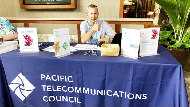 Tim Bailey of Speedcast, Wan Chai, Hong Kong, China manned the Pacific Telecommunications Council booth, at the Hilton Hawaiian Village, Honolulu, Hawaii to help promote cooperation amongst technology firms.    [photo: Barry Markowitz]