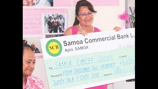Samoa Housing Corporation Chief Executive Mata'utia Rula Levi presenting their donation to the Samoa Cancer Society to assist with the early detection to cure cancer public awareness campaign.  [Courtesy photo]