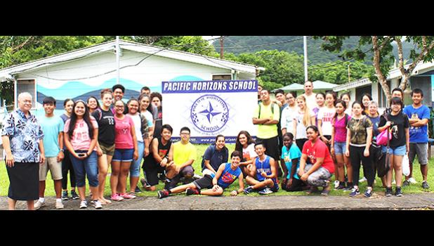 ASG Office of Political Status, Constitutional Review and Federal Relations executive director Tapaau Dr. Daniel Aga (far left) with students and teachers of Pacific Horizons School on Tuesday, as part of the office's 2018 outreach, which starts with the private schools. See story inside for details. [courtesy photo]
