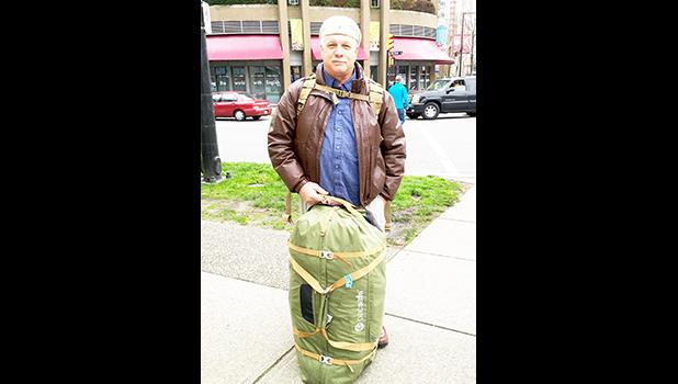 Pacsafe products are lightweight, covertly secure, and mine shown in Vancouver, Canada is even a roller duffle  [Photo by Allan Hamilton]
