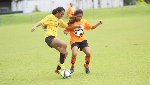 Lei Amisone, left, of Pago Youth defends against PanSa's striker Maricar Parungo during a game of the women's 2017 FFAS National League on Saturday, Sept. 23 at Pago Park Soccer Stadium.
