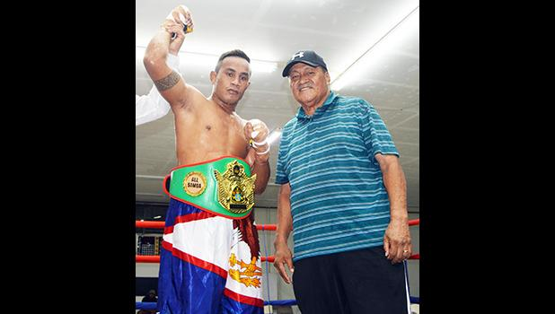 """American Samoa heavyweight champion Sui """"Cyclone"""" Palauni with his trainer and promoter, Toleafoa Henry Tavake. [photo AF]"""